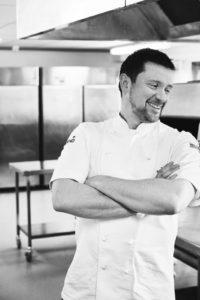 Black and white image of Tom Beauchamp, Development Chef at Sodexo