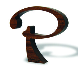 Sustainable wooden award shaped like the letter P